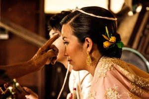 Painting the three dots on the bride's head.
