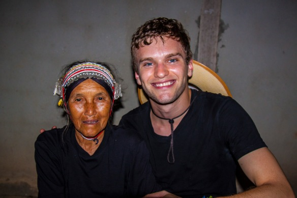 I sat down with a village elder (in traditional Akha dress) for a good ten minutes as Fame interpreted her Akha for me. While sitting with we held each others hands while she explained that she was very ill and had just gotten out of the hospital. This didn't seem to stop her beaming smile and the good laughs we had in our brief meeting.