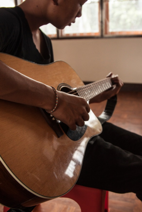 We only have one functional guitar at the center. I let the boys use mine during lessons. We need more instruments!