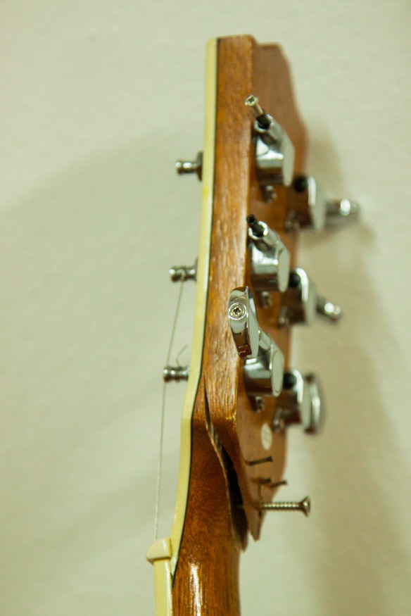 Guitar neck held together with some screws. This guitar isn't playable and needs replaced.