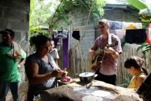 Entertaining in Honduras while baleadas are being made.